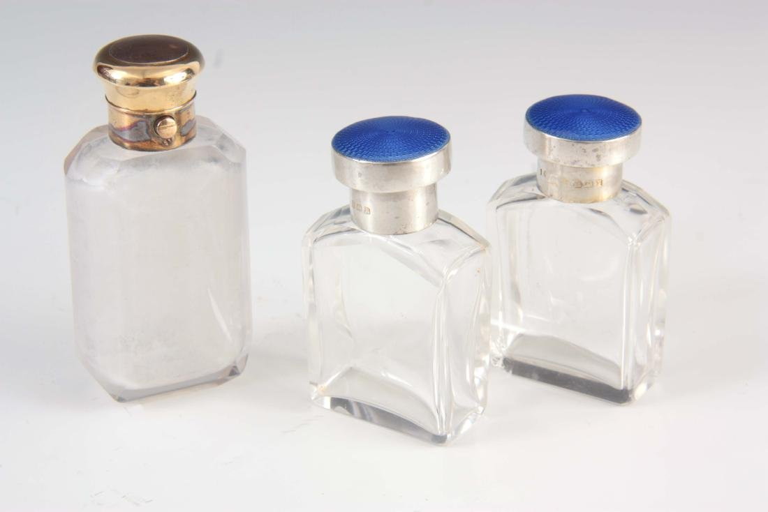 A PAIR OF SILVER ENAMEL TOPPED BOTTLES and a sprin