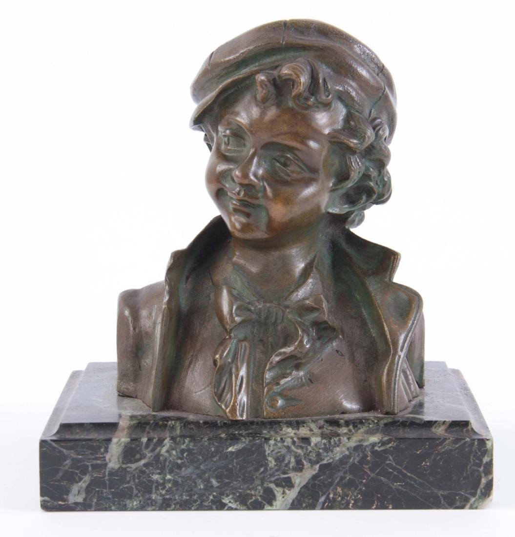 A FRENCH PATINATED BRONZE BUST of a young boy on m