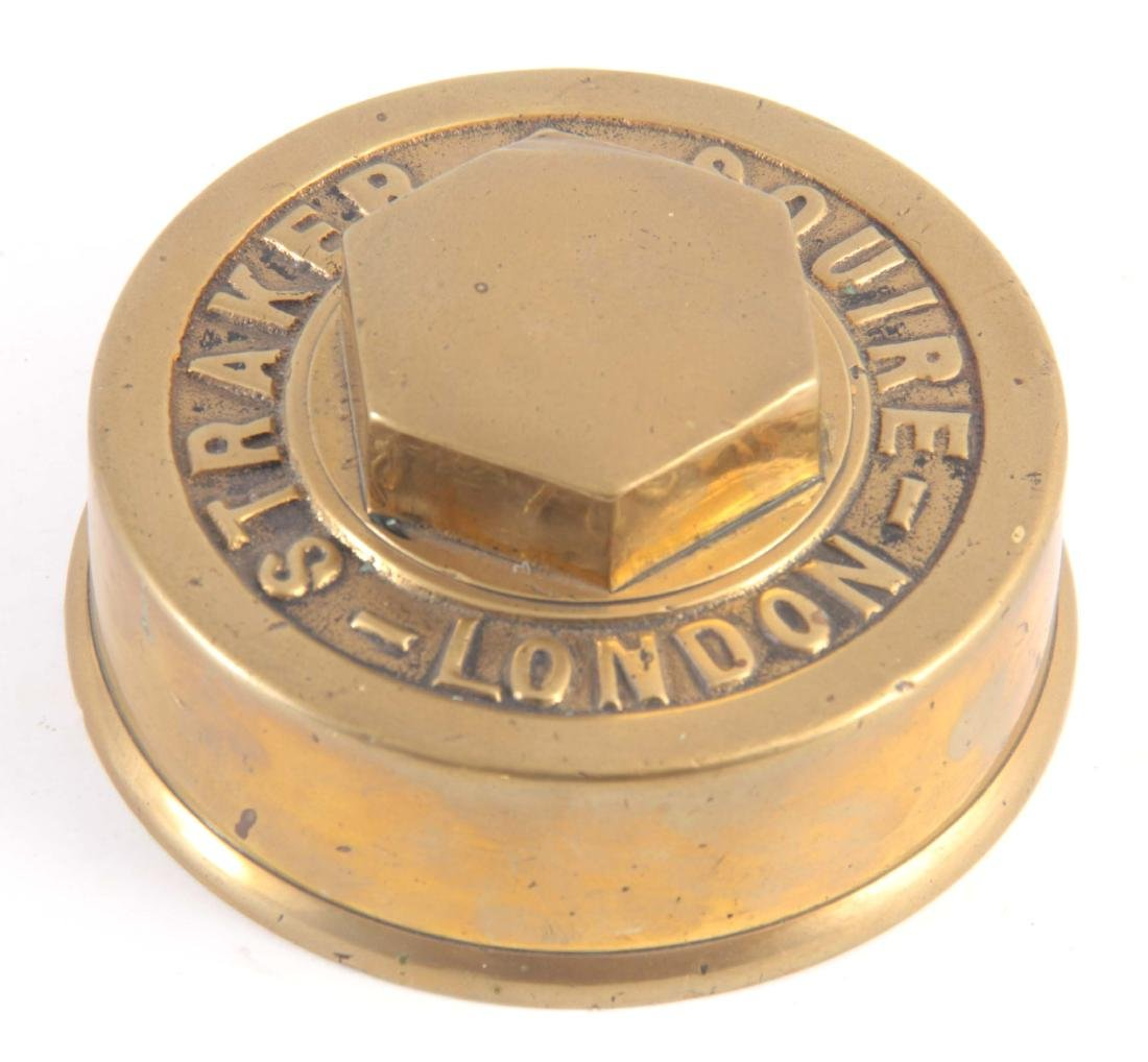 A VINTAGE BRASS HUB CAP made by 'STRAKER & SQUIRE,