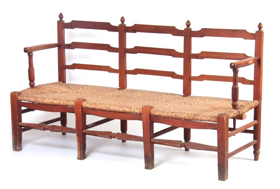 A PITCH PINE ARTS AND CRAFTS STYLE  RUSH SEATED BE
