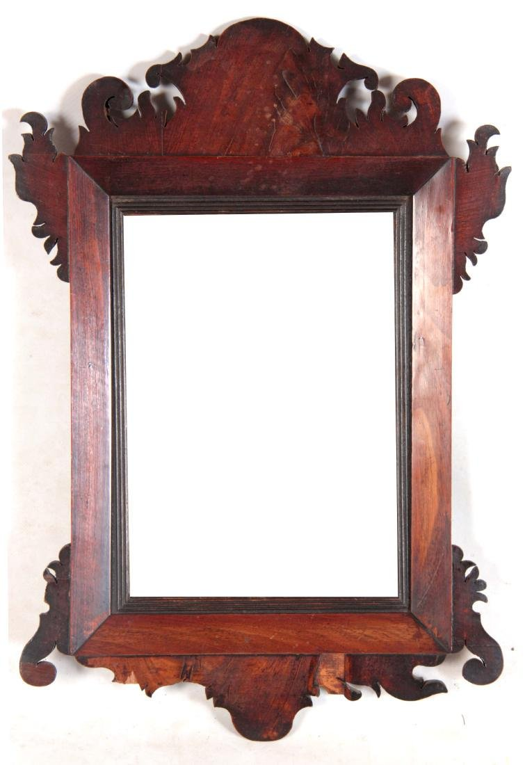 A GEORGE III FLAMED MAHOGANY HANGING MIRROR with c