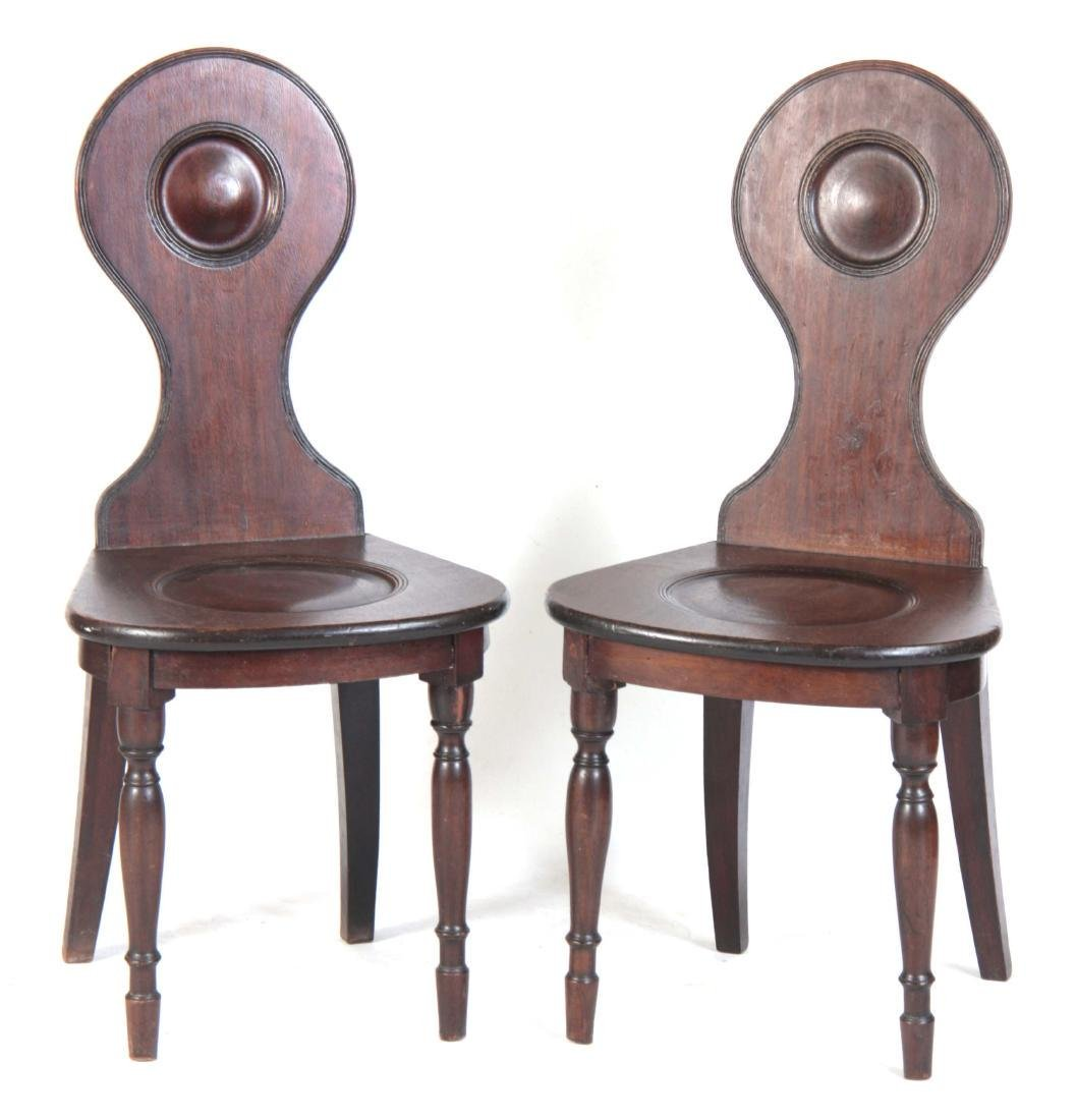 A PAIR OF LATE GEORGIAN MAHOGANY HALL CHAIRS with