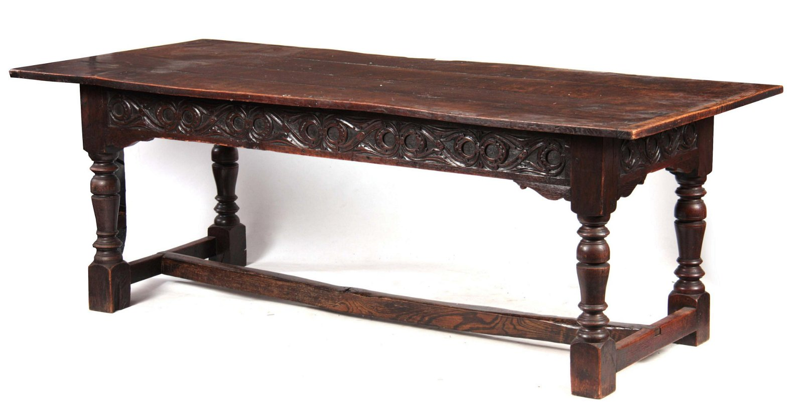 A 17TH CENTURY AND LATER OAK REFECTORY TABLE with