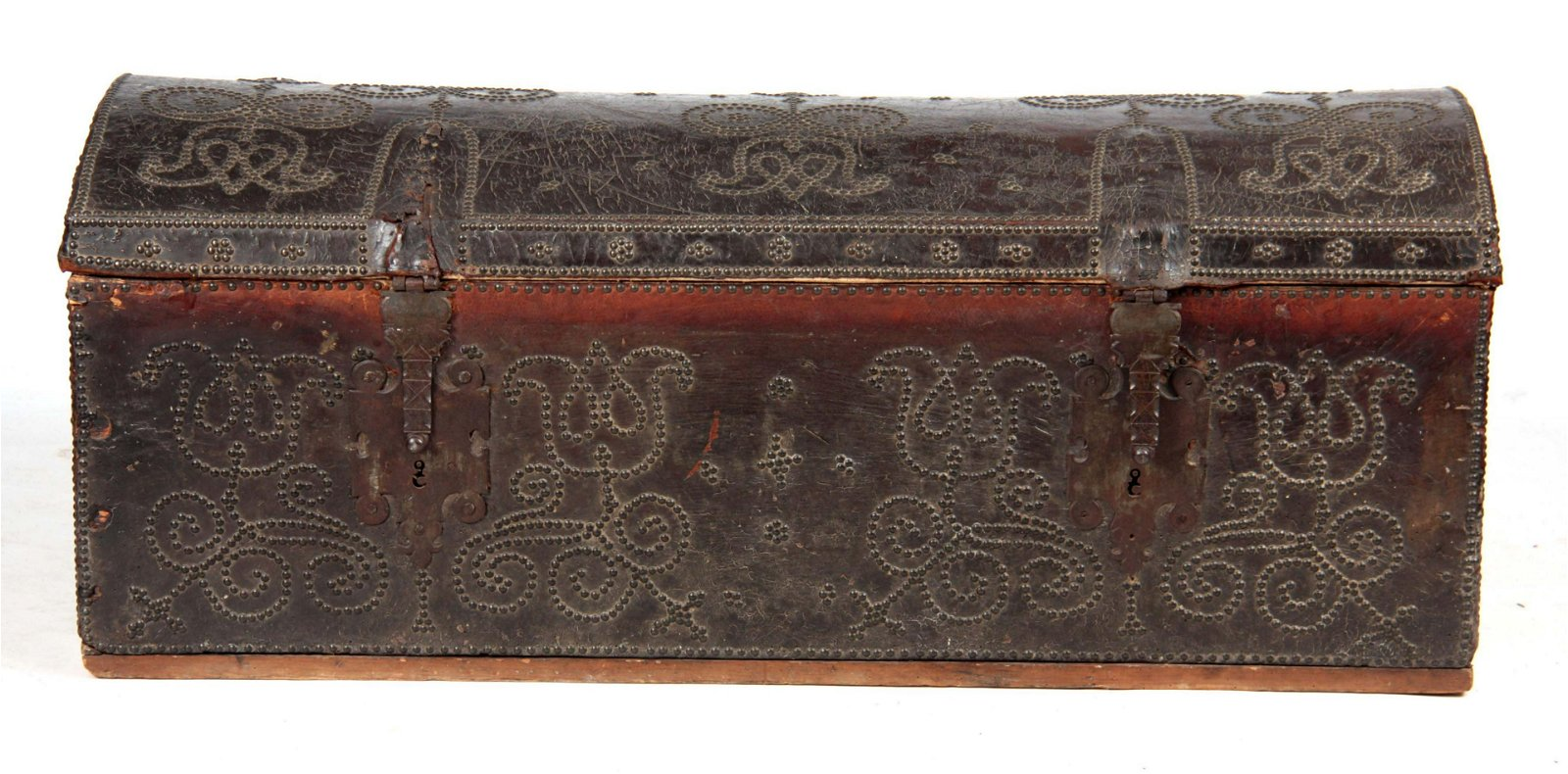 A 17TH CENTURY BRASS STUDDED LEATHER BOUND DOME-TO