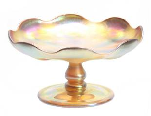 A TIFFANY FAVRILE IRIDESCENT GLASS FOOTED COMPOTE with