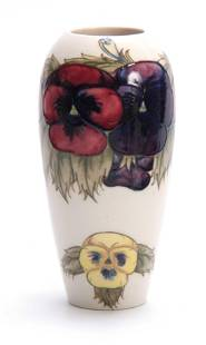 A MOORCROFT TAPERING SHOULDERED VASE decorated with