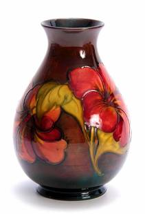 A WALTER MOORCROFT FLAMBE BALUSTER VASE with colourful
