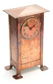 A NICE QUALITY ARTS AND CRAFTS COPPER MANTEL CLOCK WITH