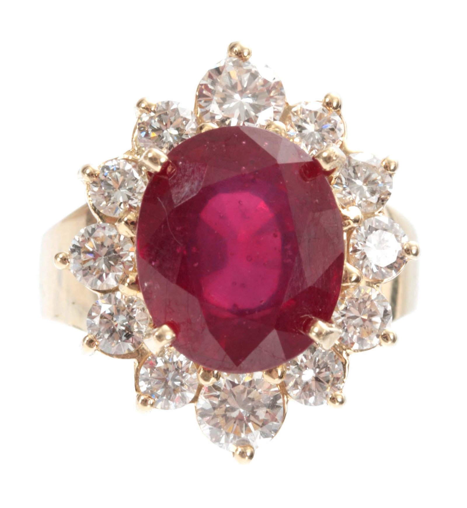 A LADIES 14ct GOLD RUBY AND DIAMOND RING having a