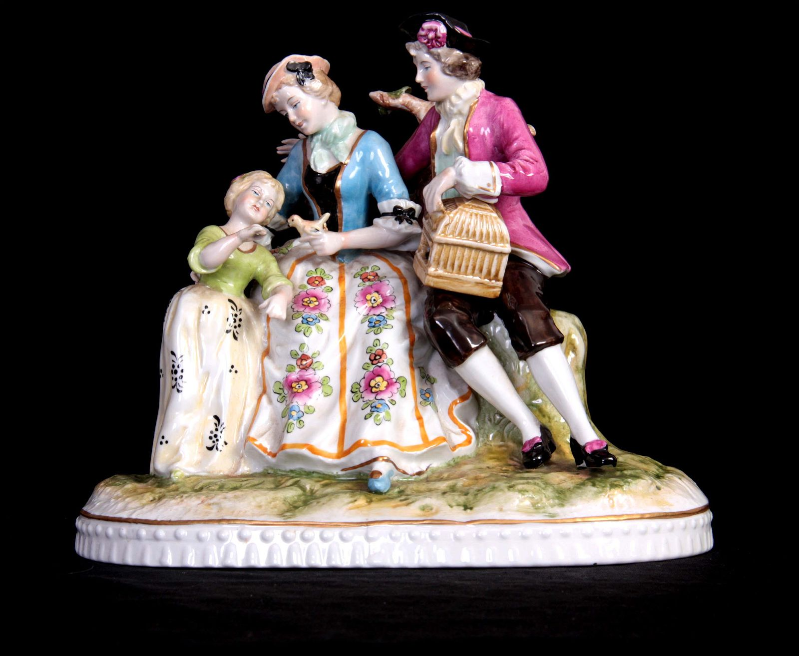 A 19TH CENTURY CONTINENTAL FIGURE GROUP depicting