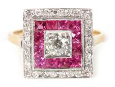 AN ART DECO STYLE DIAMOND AND RUBY CLUSTER RING with