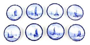 A SET OF EIGHT ROYAL CROWN DERBY SMALL HANGING PLATES