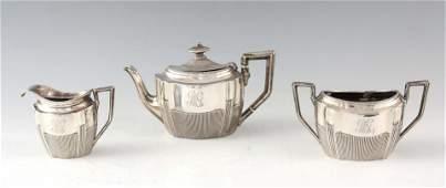 A LATE VICTORIAN SILVER THREE PIECE TEA SERVICE each