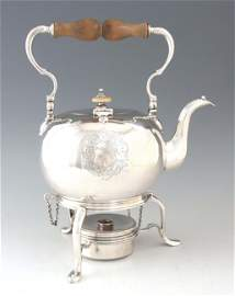 A GEORGE I SILVER KETTLE ON STAND the hinged swan neck