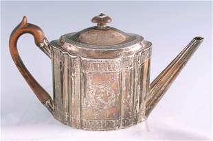 A GEORGE III SILVER TEAPOT of oblate fluted form with