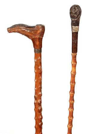 TWO 19TH CENTURY BLACK FOREST CARVED WALKING STICKS one