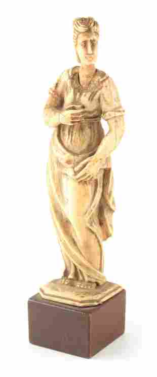 AN 18TH/19TH CENTURY EUROPEAN CARVED IVORY FIGURE OF A