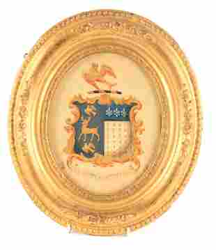 A GILT AND PAINTED FRAMED COAT OF ARMS from Hall i' th'