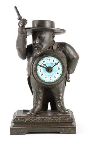A LATE 19TH CENTURY FRENCH FIGURAL ALARM CLOCK modelled