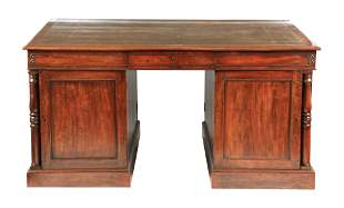 A LATE GOERGE III MAHOGANY PARTNERS DESK having a green