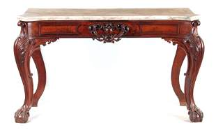 A REGENCY MAHOGANY SERPENTINE SERVING TABLE with white