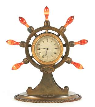 A 19TH CENTURY GILT BRASS SHIP'S WHEEL CLOCK WITH AGATE