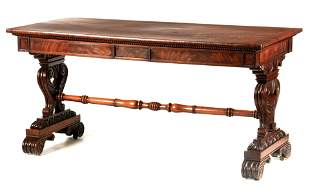 A FINE LATE REGENCY FIGURED MAHOGANY LIBRARY TABLE IN