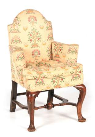 AN EARLY 18TH CENTURY WALNUT UPHOLSTERED ARMCHAIR with