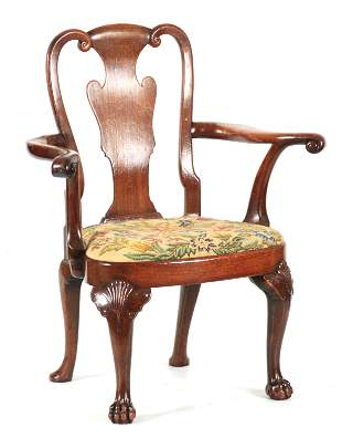 A FINE GEORGE I WALNUT OPEN ARMCHAIR with scrolled