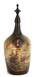 AN 18TH CENTURY GREEN GLASS BOTTLE WITH PAINTED NA