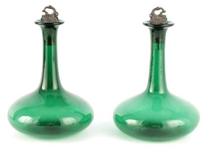 A PAIR OF LATE GEORGIAN BRISTOL GREEN DECANTERS wi