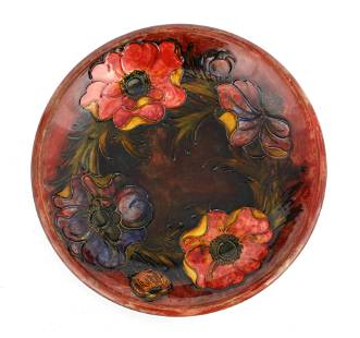A WILLIAM MOORCROFT SHALLOW DISH tube lined and de