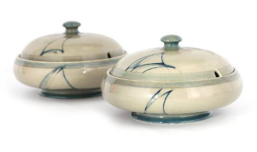 A PAIR OF MOORCROFT LIDDED TABLE TUREENS decorated