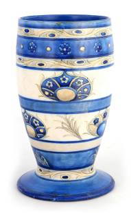 A MOORCROFT FOOTED OVOID VASE decorated in the ban