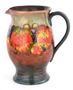 A 1930S MOORCROFT OVOID JUG WITH RIBBED FOOT decor