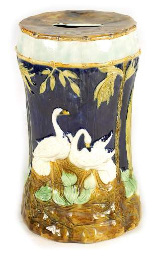 A LATE 19TH CENTURY MAJOLICA GARDEN SEAT decorated