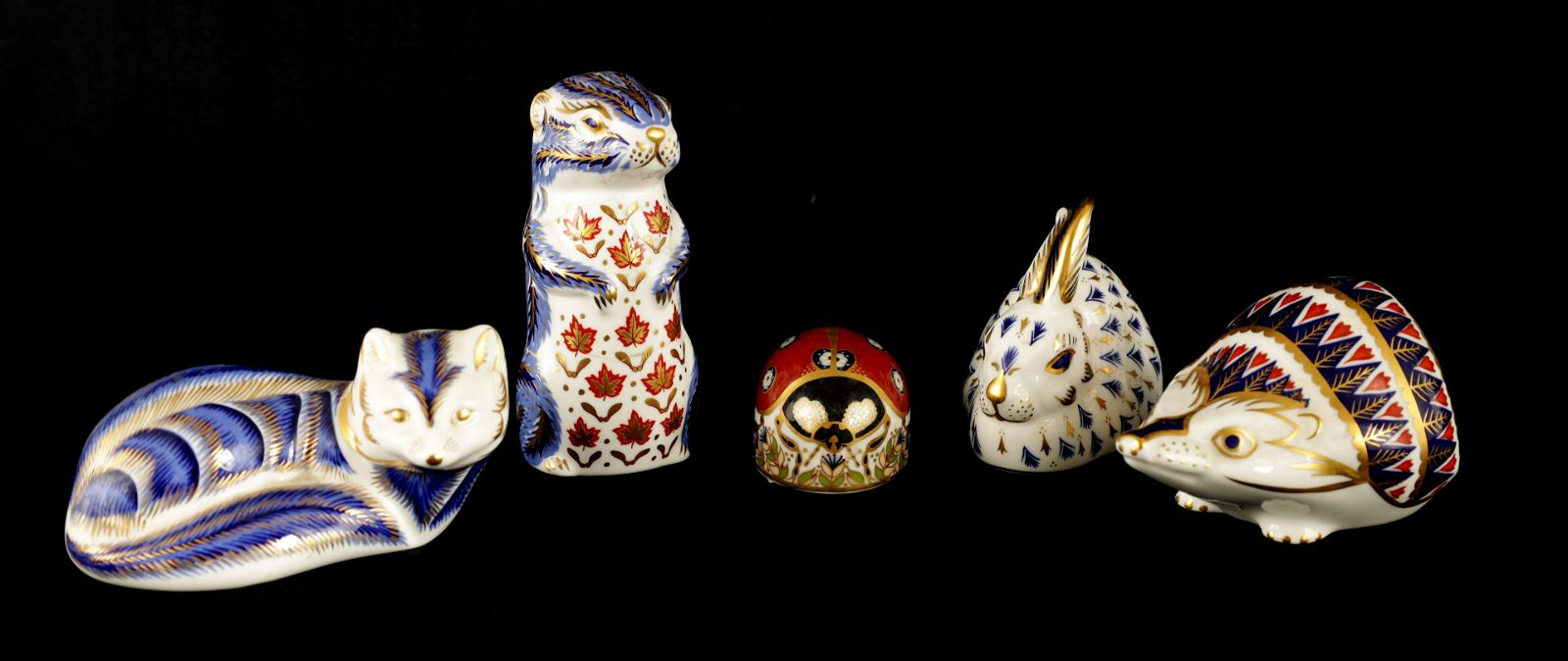 A GROUP OF FIVE VARIOUS ROYAL CROWN DERBY PAPERWEI