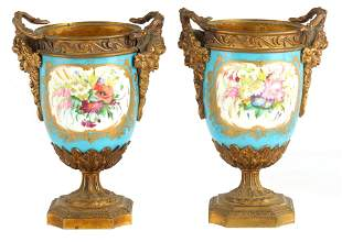 A PAIR OF 19TH CENTURY ORMOLU MOUNTED SERVES URNS