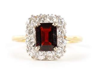 A LADIES 18CT GOLD AND PLATINUM RUBY AND DIAMOND R