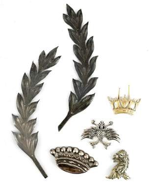 A SELECTION OF SOLID SILVER BADGES AND MOUNTS depi