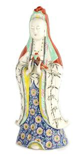 AN EARLY 19TH CENTURY CHINESE PORCELAIN GUANYIN wi