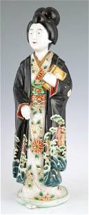 A LARGE MEIJI PERIOD JAPANESE KUTANI FIGURE OF A G