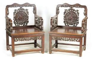 A PAIR OF 19TH CENTURY CHINESE CARVED HARDWOOD ARM
