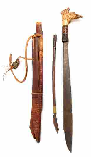 A 19TH CENTURY MODANG DAYAK MANDAU SWORD having a
