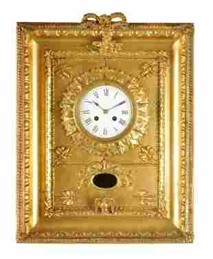 A 19TH CENTURY FRENCH GILT FRAMED STRIKING WALL CL