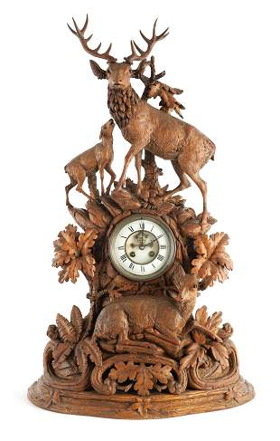 A LARGE LATE 19TH CENTURY CARVED BLACK FOREST MANT