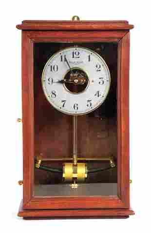 AN EARLY 20TH CENTURY ELECTRIC BULLE WALL CLOCK th