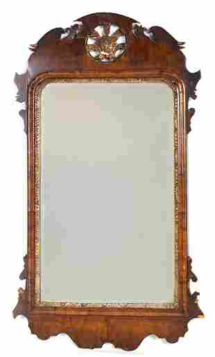 AN 18TH CENTURY WALNUT HANGING MIRROR with scrolle