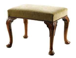 A GEORGE II WALNUT STOOL with upholstered top rais