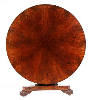 A LATE REGENCY FLAME MAHOGANY CENTRE TABLE with a